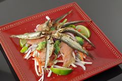 Smoked salmon and sprats. With vegetables and lemon Stock Image