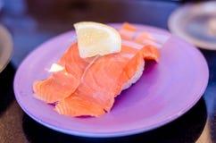 Smoked Salmon sushi with lemon on purple dish. Stock Images