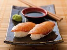 Smoked Salmon Sushi Nigiri. A delicious smoked salmon nigiri-zushi with wasabi paste and japanese soy stock images