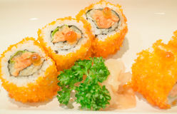 Smoked salmon sushi roll on plate Royalty Free Stock Image