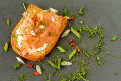 Smoked salmon on toasted bread Royalty Free Stock Images