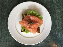 Smoked salmon on a toasted bread. A top view shot of smoked salmon on a toasted bread Stock Photo