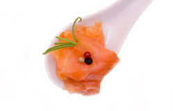 Smoked salmon on top and spoon seen closely Stock Photos
