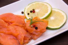 Smoked salmon in tray on wood seen up very close Royalty Free Stock Images