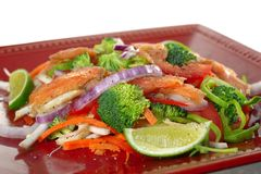 Smoked salmon with vegetables. And lemon salad Royalty Free Stock Images