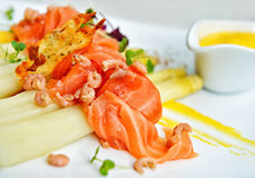 Smoked salmon with white asparagus Stock Photo