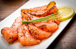Smoked salmon on white dish with chive Stock Photography