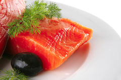 Smoked salmon on white plate Stock Images