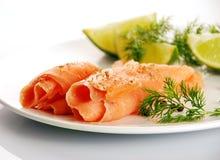 Smoked salmon on white plate Royalty Free Stock Photo