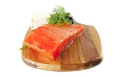 Smoked salmon on wooden plate Stock Photos