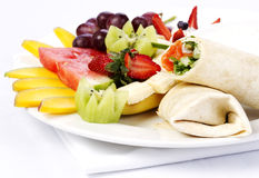 Smoked salmon wrap with assorted fruits Stock Images