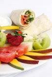 Smoked salmon wrap with assorted fruits Stock Image