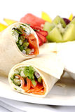 Smoked salmon wrap with assorted fruits Royalty Free Stock Photo