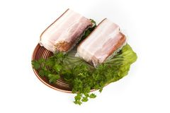 Smoked salted bacon with greens. On a white background royalty free stock photography