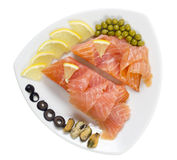 Smoked salted salmon on a plate Royalty Free Stock Images