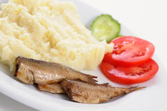 Smoked sardine with potato mash Royalty Free Stock Photos