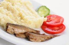 Smoked sardine with potato mash royalty free stock photos
