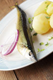 Smoked saury with boiled potato Stock Image