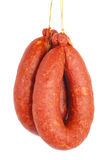 Smoked Sausage. Pram smoked sausage on a white background Stock Image