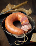 Smoked sausage. In a frying pan,shallow focus Royalty Free Stock Photos