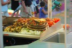 Smoked sausage. Freshly prepared smoked sausage at the county fair Stock Photos