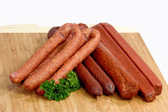 Smoked sausage. Assorted smoked sausage on a kitchen board Stock Images