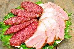 Smoked sausage and bacon Stock Photos