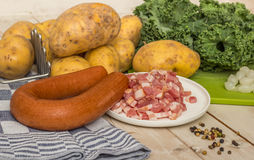 Smoked sausage and bacon with potatoes and kale. Smoked sausage and bacon with potatoes, kale and pepper Stock Photos