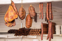 Smoked Sausage and Bacon in a street market Royalty Free Stock Photo