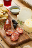 Smoked sausage, cheese, bread and glass Stock Image