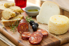 Smoked sausage, cheese, bread and glass Stock Images