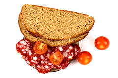 Smoked sausage, cherry tomatoes and bread Stock Image