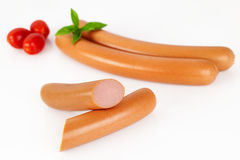 Smoked sausage with cherry tomatoes isolated on white background. Raw meat. Horizontal shot Stock Image