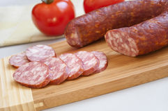 Smoked sausage on a cutting board Royalty Free Stock Images