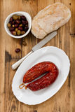 Smoked sausage on dish on white dish Stock Photo