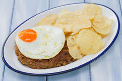 Smoked sausage with fried egg and potato Royalty Free Stock Images