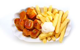 Smoked sausage and golden French fries Royalty Free Stock Photo