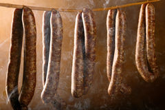 Smoked sausage in a haze of smoke Stock Photo