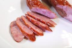 Smoked sausage from homemade pigs. Smoked sausage. stock photos