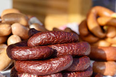 Smoked sausage is homemade on the trade counter Royalty Free Stock Photos