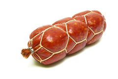 Smoked sausage isolated on white background close-up Royalty Free Stock Photos