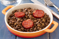 Smoked sausage with lentil on dish Stock Photography