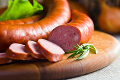 Smoked sausage. Macro shot , focus on a foreground Royalty Free Stock Image