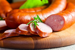 Smoked sausage. Macro shot , focus on a foreground Royalty Free Stock Photo