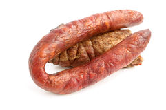 Smoked sausage and meat. On a white background Royalty Free Stock Photos