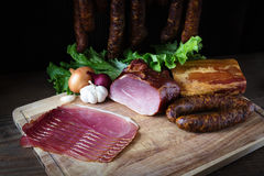 Smoked sausage and meat. Collage of different kinds of meat, smoked sausage and meat Stock Images