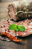 Smoked sausage with mint and peppercorns Royalty Free Stock Photo