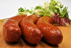 Smoked sausage and organic salad Royalty Free Stock Photography