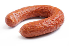 Smoked sausage over white Royalty Free Stock Photos
