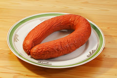 Smoked sausage on plate Stock Image